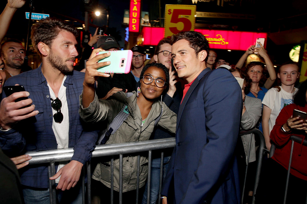 """. Orlando Bloom seen at Open Road Films US Premiere of \""""The Promise\"""" at TCL Chinese Theatre on Wednesday, April 12, 2017, in Los Angeles. (Photo by Eric Charbonneau/Invision for Open Road Films/AP Images)"""