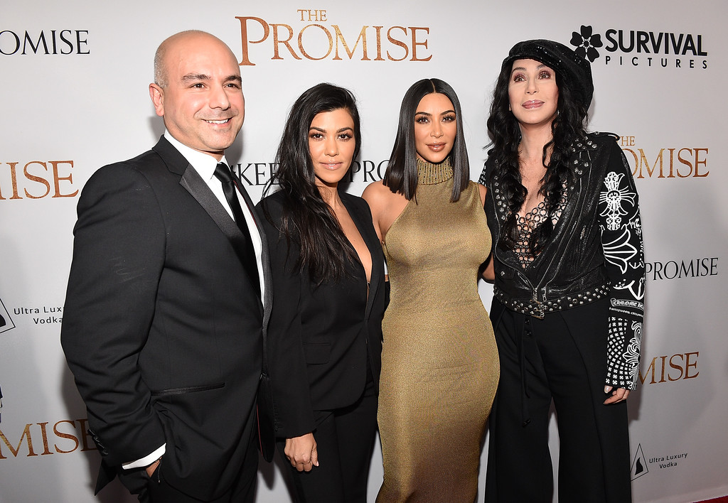 """. HOLLYWOOD, CA - APRIL 12:  (L-R) Producer Eric Esrailian, TV personalities Kourtney Kardashian, Kim Kardashian West and actor/singer Cher attend the premiere of Open Road Films\' \""""The Promise\"""" at TCL Chinese Theatre on April 12, 2017 in Hollywood, California.  (Photo by Kevork Djansezian/Getty Images)"""