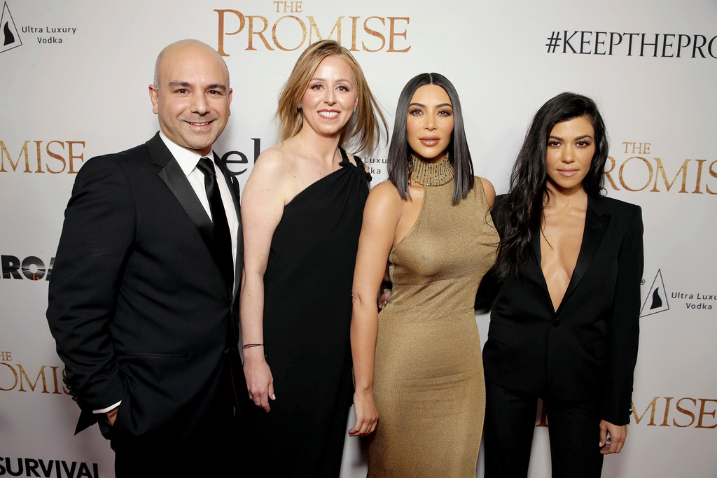 ". Producer Eric Esrailian, Melina Esrailian, Kim Kardashian and Kourtney Kardashian seen at Open Road Films US Premiere of ""The Promise\"" at TCL Chinese Theatre on Wednesday, April 12, 2017, in Los Angeles. (Photo by Eric Charbonneau/Invision for Open Road Films/AP Images)"