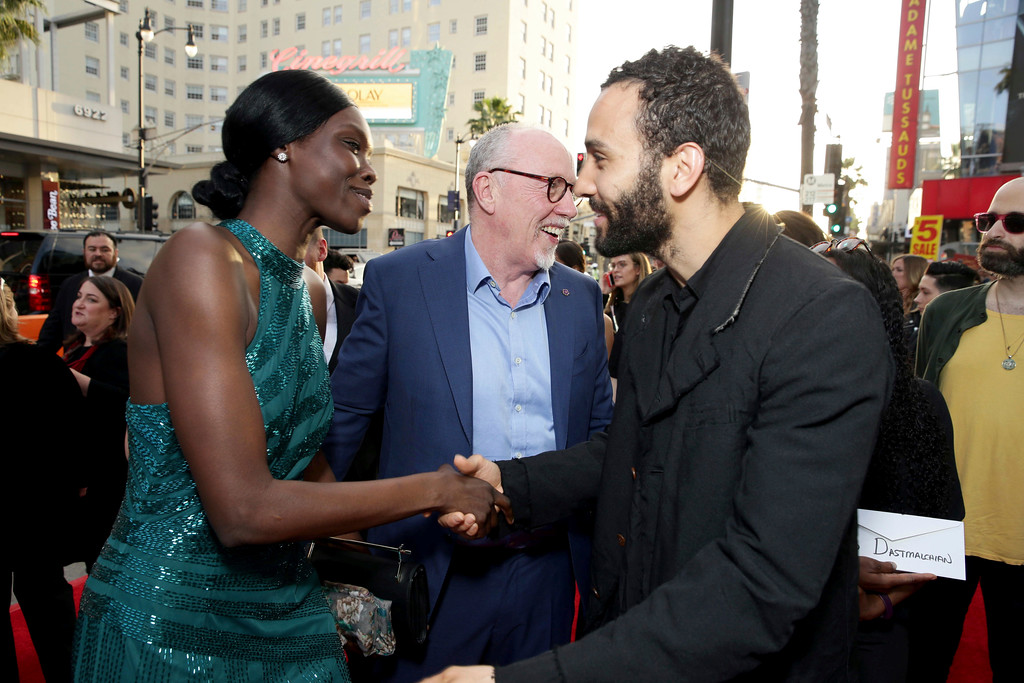 """. Margaret Higgins, Writer/Director Terry George and Marwan Kenzari seen at Open Road Films US Premiere of \""""The Promise\"""" at TCL Chinese Theatre on Wednesday, April 12, 2017, in Los Angeles. (Photo by Eric Charbonneau/Invision for Open Road Films/AP Images)"""