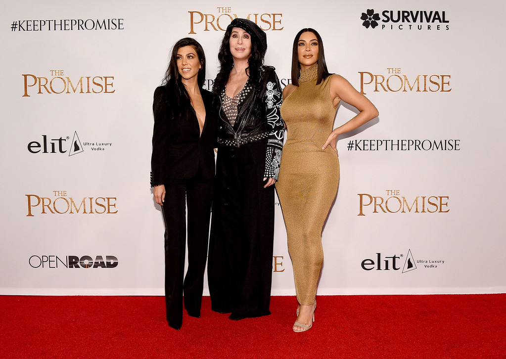 """. HOLLYWOOD, CA - APRIL 12:  TV personality Kourtney Kardashian, singer/actor Cher, and TV personality Kim Kardashian West attend the premiere of Open Road Films\' \""""The Promise\"""" at TCL Chinese Theatre on April 12, 2017 in Hollywood, California.  (Photo by Kevork Djansezian/Getty Images)"""