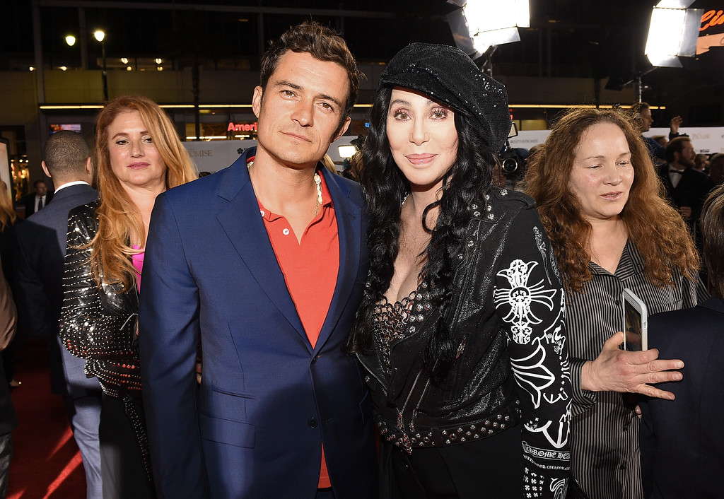""". HOLLYWOOD, CA - APRIL 12:  Actor Orlando Bloom (L) and actor/singer Cher attend the premiere of Open Road Films\' \""""The Promise\"""" at TCL Chinese Theatre on April 12, 2017 in Hollywood, California.  (Photo by Kevork Djansezian/Getty Images)"""