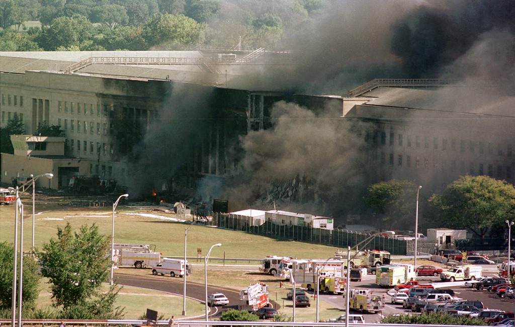 . FILE - In this Sept. 11, 2001 file photo, the south side of the Pentagon burns after a plane crash in Washington.   (AP Photo/Tom Horan, File)