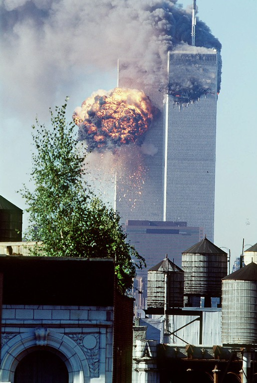 . A fireball erupts from one of the World Trade Center towers as it is struck by the second of two airplanes in New York, Tuesday, Sept. 11, 2001. In a horrific sequence of destruction, terrorists hijacked two airliners and crashed them into the World Trade Center in a coordinated series of attacks that brought down the twin 110-story towers. (AP Photo/Todd Hollis)