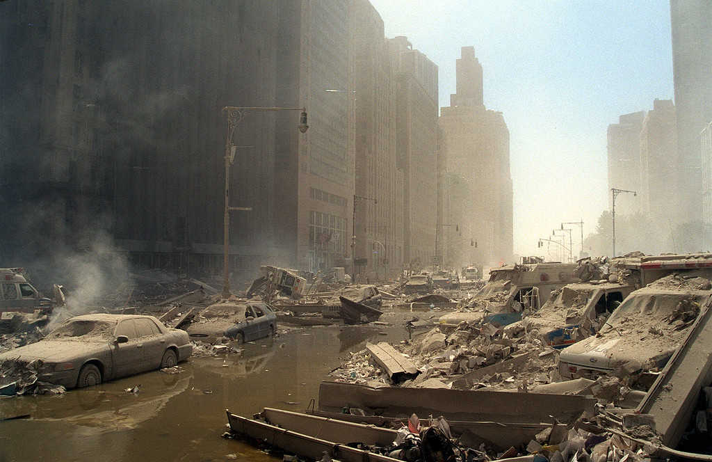 . Rubble and ash fill lower Manhattan streets after two hijacked airliners were crashed into the towers of the World Trade Center in New York, Tuesday, Sept. 11, 2001. The planes crashed into the upper floors of both World Trade Center towers minutes apart collapsing the 110-story buildings. (AP Photo/Boudicon One)