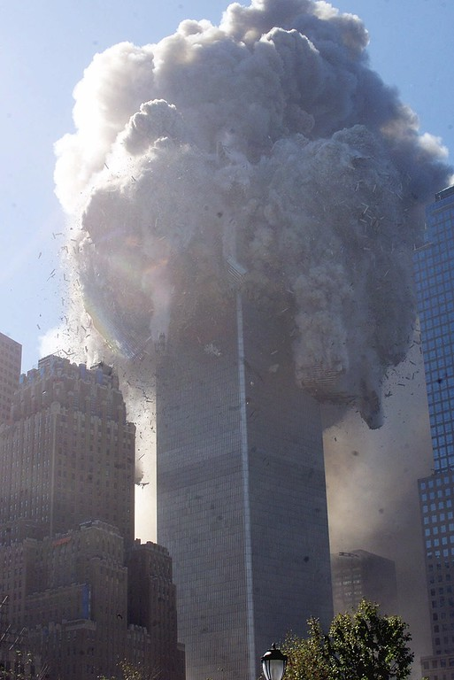 . The north tower of New York\'s World Trade Center begins to collapse Tuesday Sept. 11, 2001, following a terrorist attack on the former landmark that brought both towers to the ground. (AP Photo/Richard Drew)