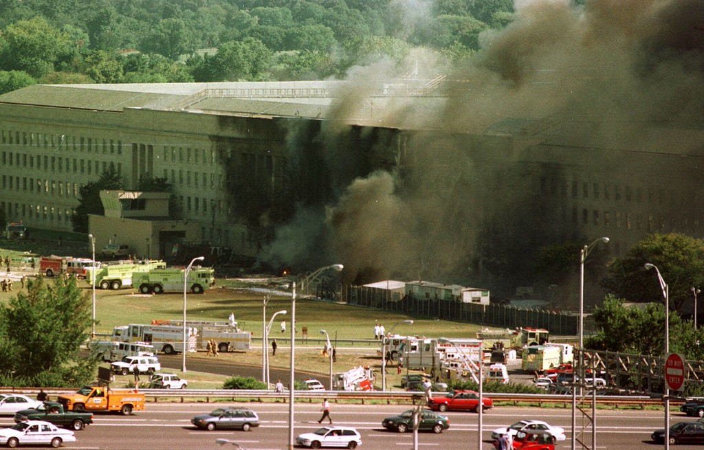 . Vehicles are shown traveling on Interstate 395, leaving Washington, in front of the Pentagon, following an explosion Tuesday, Sept. 11, 2001.  (AP Photo/Tom Horan)