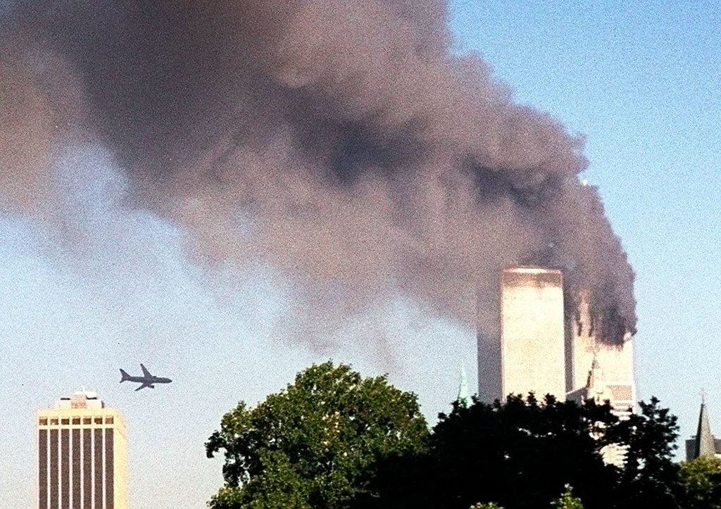 . A plane approaches New York\'s World Trade Center moments before it struck the tower at left, as seen from downtown Brooklyn, Tuesday, Sept. 11, 2001. In an unprecedented show of terrorist horror, the 110 story towers collapsed in a shower of rubble and dust after 2 hijacked airliners carrying scores of passengers slammed into them. (AP Photo/ William Kratzke)