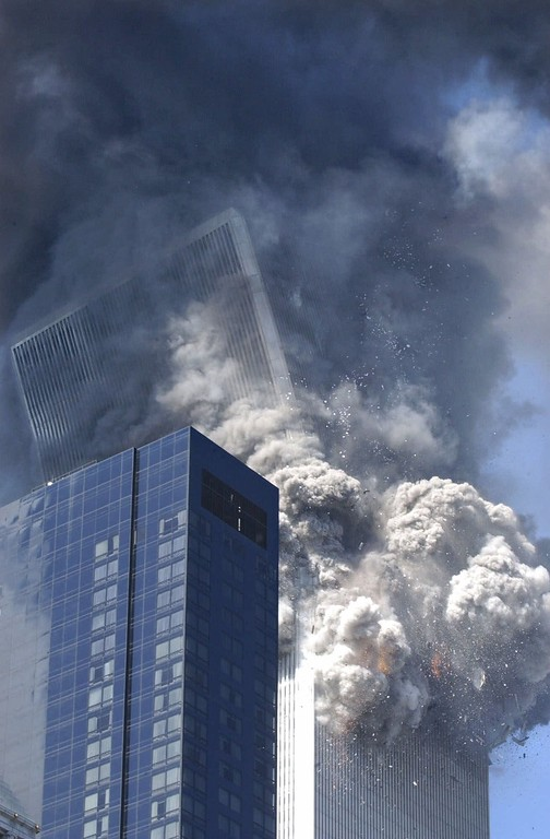 . The south tower of the World Trade Center begins to collapse following a terrorist attack on the New York landmark Tuesday, Sept. 11, 2001. (AP Photo/Amy Sancetta)
