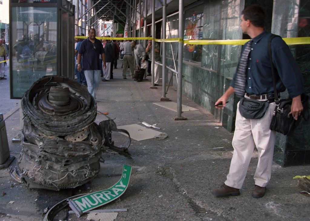 . A piece of debris, possibly from one of the crashed airliners, is roped off by investigators near the World Trade Center site in New York, Tuesday, Sept. 11, 2001. Two planes crashed into the upper floors of the World Trade Center towers minutes apart Tuesday morning, collapsing the 110-story buildings. (AP Photo/Lucian Mihaesteanu)