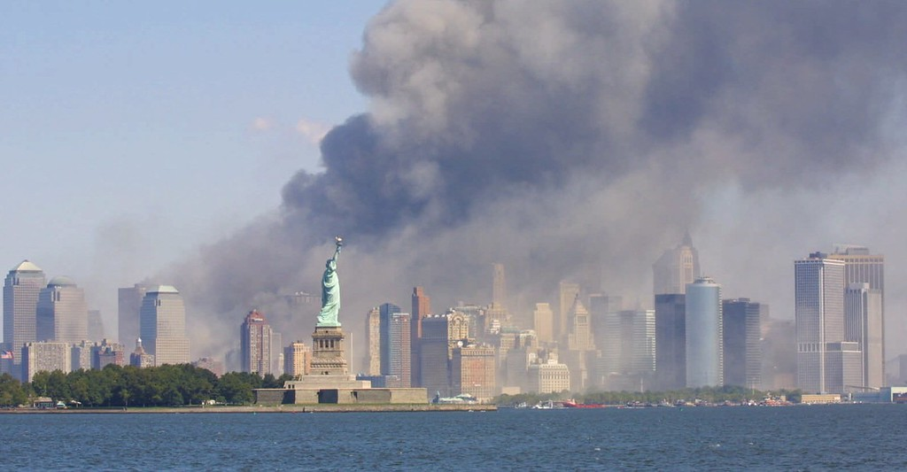 . The Statue of Liberty stands as smoke billows from the World Trade Center in New York, Tuesday, Sept 11, 2001 after terrorists crashed two hijacked airliners into the World Trade Center and brought down the twin 110-story towers. (AP Photo/Stuart Ramson)