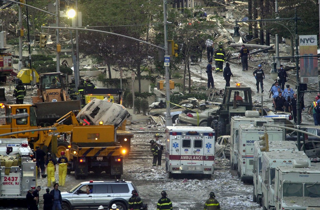 . Firefighters, rescue workers and other personnel work on clearing the area of the remains of the World Trade Center Twin Towers\' in downtown New York Wednesday, Sept. 12, 2001. (AP Photo Lawrence Jackson)