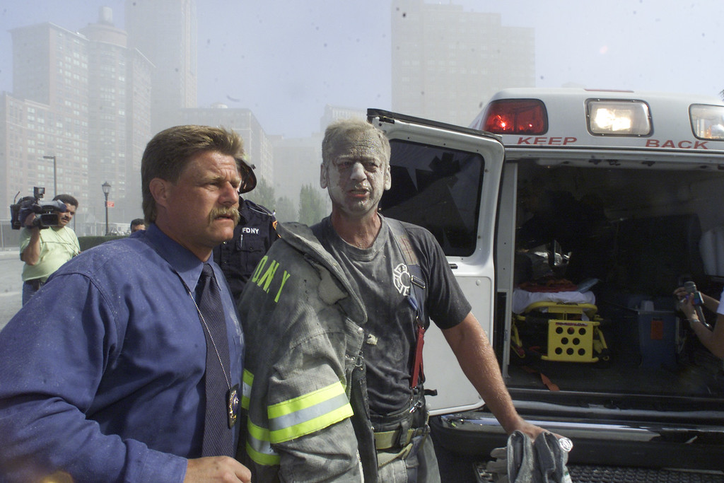 . A fireman is covered in debris after the collapse of the twin towers of the World Trade Center on September 11, 2001 in New York City.(AP Photo/Richard Drew)