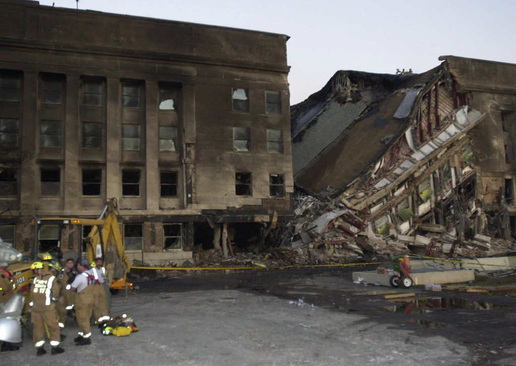 . Damage to the outer ring of the Pentagon is shown Tuesday, Sept. 11, 2001, after a hijacked airliner crashed into the building. (AP Photo/Steve Helber)