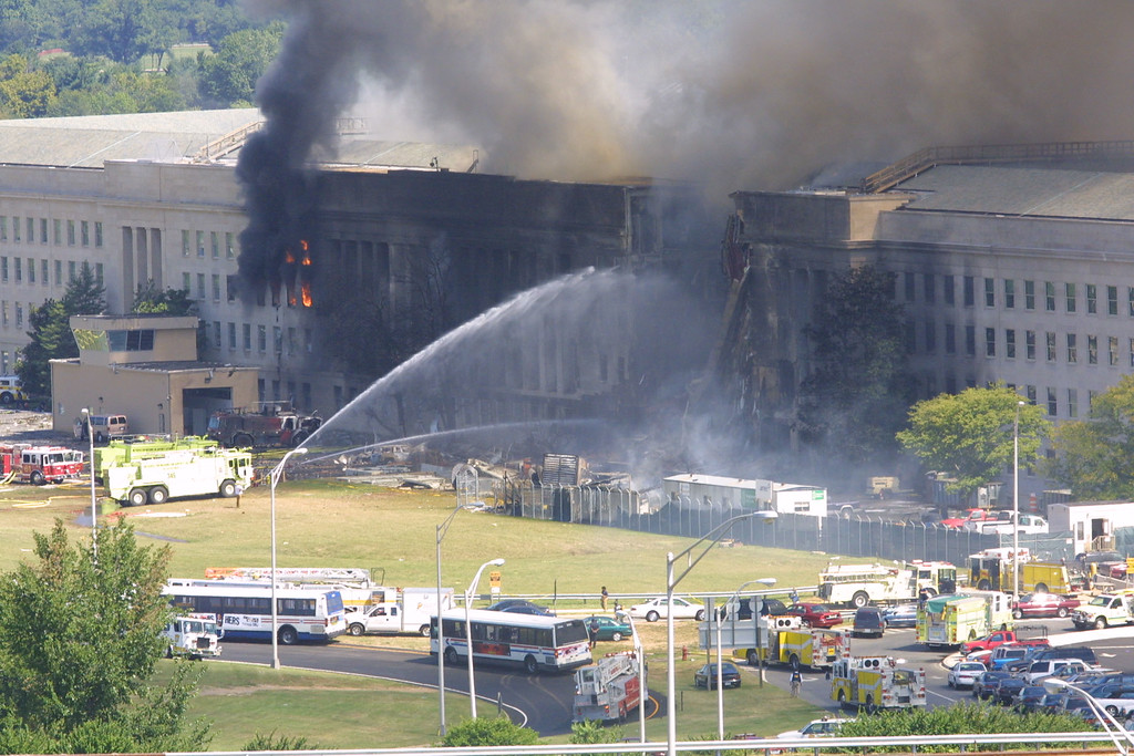 . Smoke comes out from the west wing of the Pentagon building September 11, 2001 in Arlington, Va., after a plane crashed into the building and set off a huge explosion. (Photo by Alex Wong/Getty Images)
