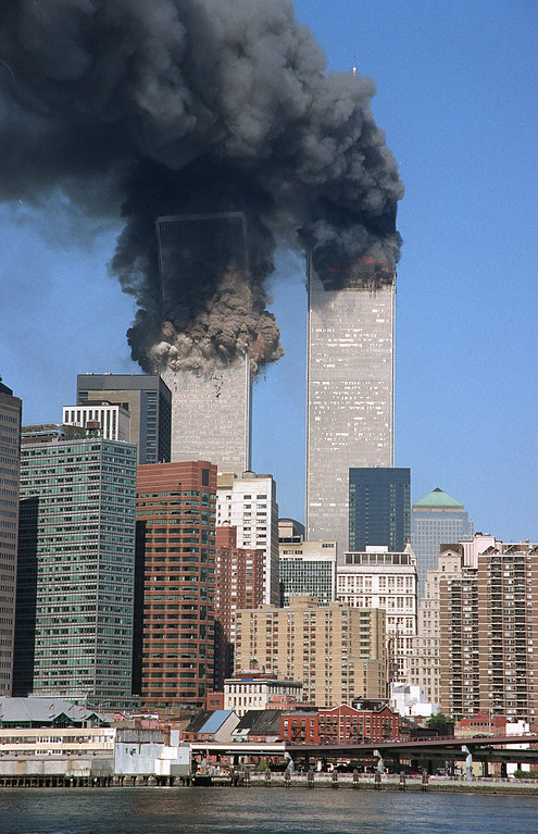 . The south tower begins to collapse as smoke billows from both towers of the World Trade Center, in New York, in this Sept. 11, 2001, file photo. In one of the most horrifying attacks ever against the United States, terrorists crashed two airliners into the World Trade Center in a deadly series of blows that brought down the twin 110-story towers. (AP Photo/Jim Collins/FILE)