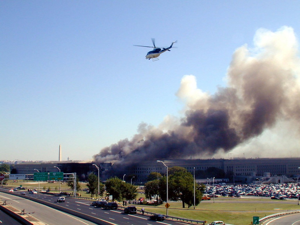 . Smoke pours from the Pentagon after a hijacked airliner crashed into the building Tuesday, Sept, 11, 2001. (AP Photo/U.S. Navy, Journalist 1st Class Mark D. Faram)