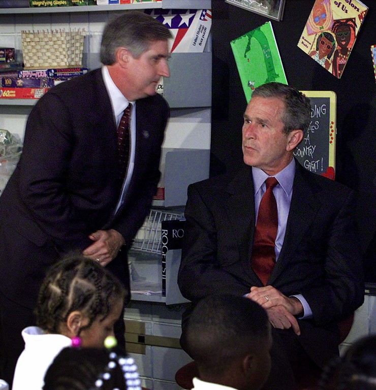 . A stunned President George W. Bush looks past Chief of Staff Andrew Card after Card told the President about the planes crashing into the World Trade Center in New York City, during Bush\'s visit to the Emma E. Booker Elementary School in Sarasota, Fla., Tuesday, Sept. 11, 2001. (AP Photo/Doug Mills)