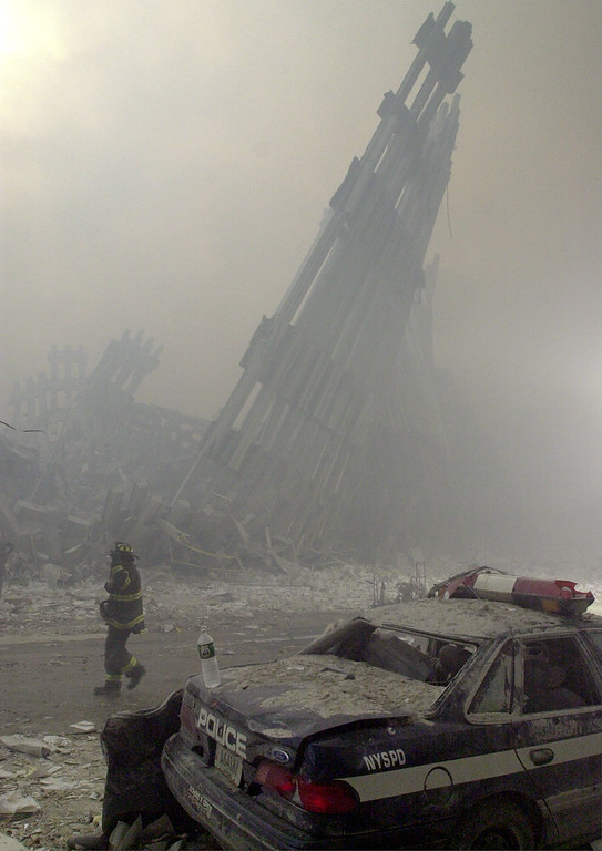 . Destroyed mullions, the vertical struts which once faced the soaring outer walls of the World Trade Center towers, are the only thing left standing behind a lone fireman, after a terrorist attack on the twin towers of lower Manhattan Tuesday, Sept. 11, 2001. In an unprecedented show of terrorist horror, the 110-story towers collapsed in a shower of rubble and dust after two hijacked airliners carrying scores of passengers slammed into the sides of the twin symbols of American capitalism. (AP Photo/Mark Lennihan)