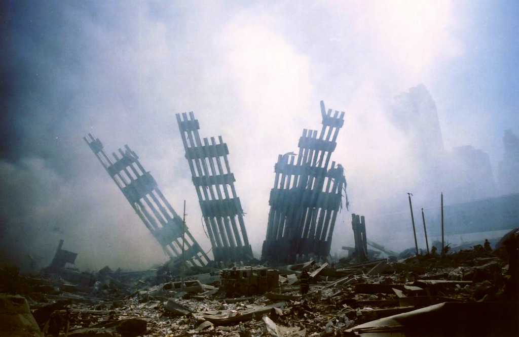 . The remains of the World Trade Center stands amid the debris following the terrorist attack on the building in New York, Tuesday, Sept. 11, 2001. (AP Photo/Alexandre Fuchs)