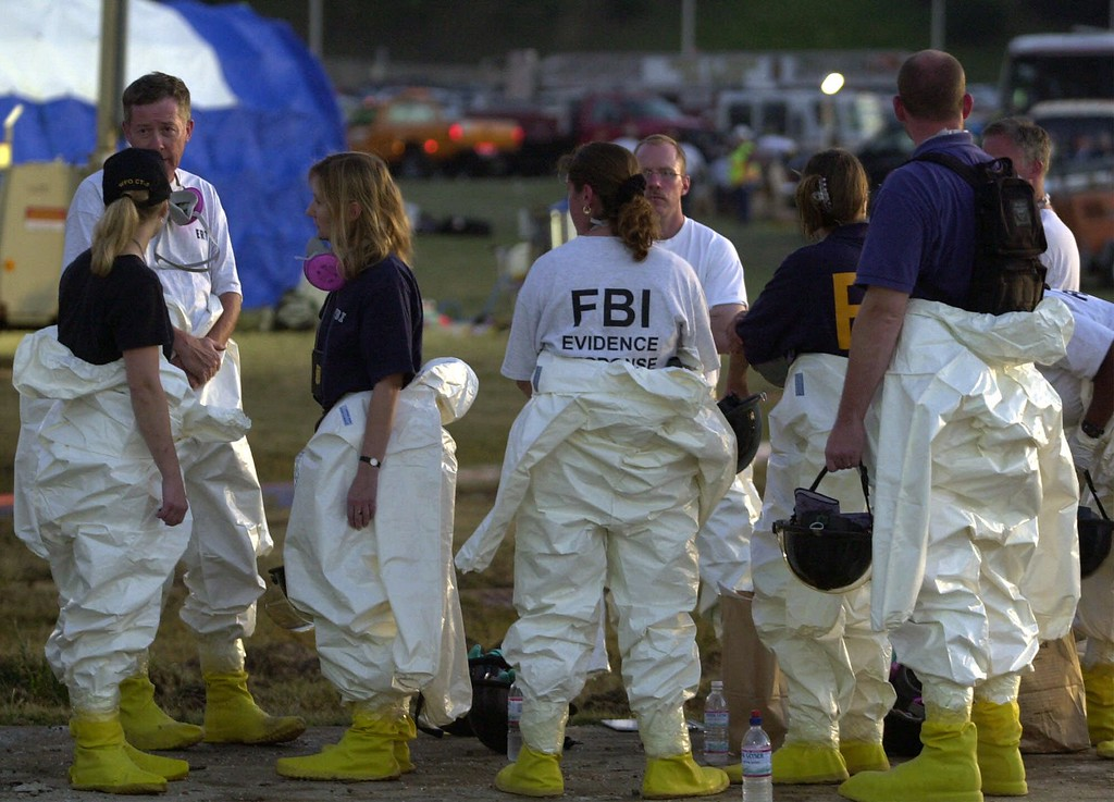 . Rescue workers gather outside the Pentagon, Tuesday, Sept. 11, 2001, after a hijacked airliner crashed into the building. (AP Photo/Steve Helber)