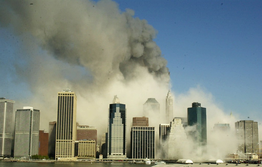 . This is a view of the Manhattan skyline from Brooklyn, Tuesday, Sept. 11, 2001, after the World Trade Center towers collapsed following being struck by airplanes. (AP Photo/Kathy Willens)