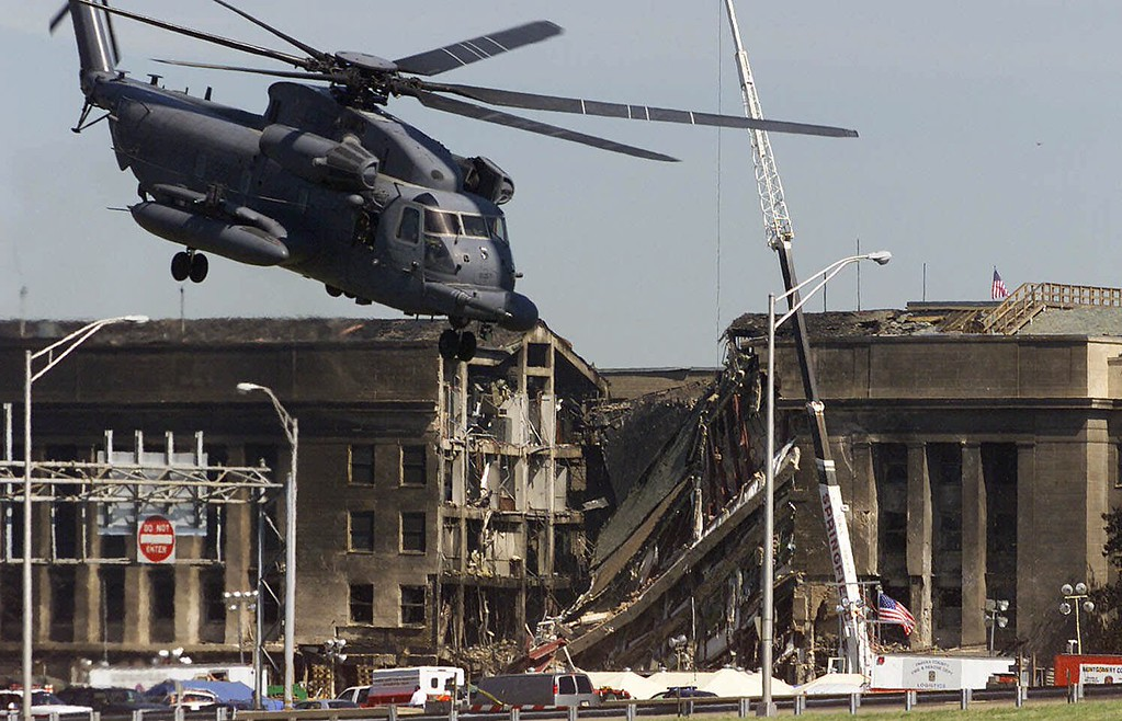 . A military helicopter takes off after dropping off personnel at the Pentagon, Wednesday, Sept. 12, 2001, as work continued at the Pentagon after a terrorist crashed a hijacked airliner into the building Tuesday. (AP Photo/Ron Edmonds)