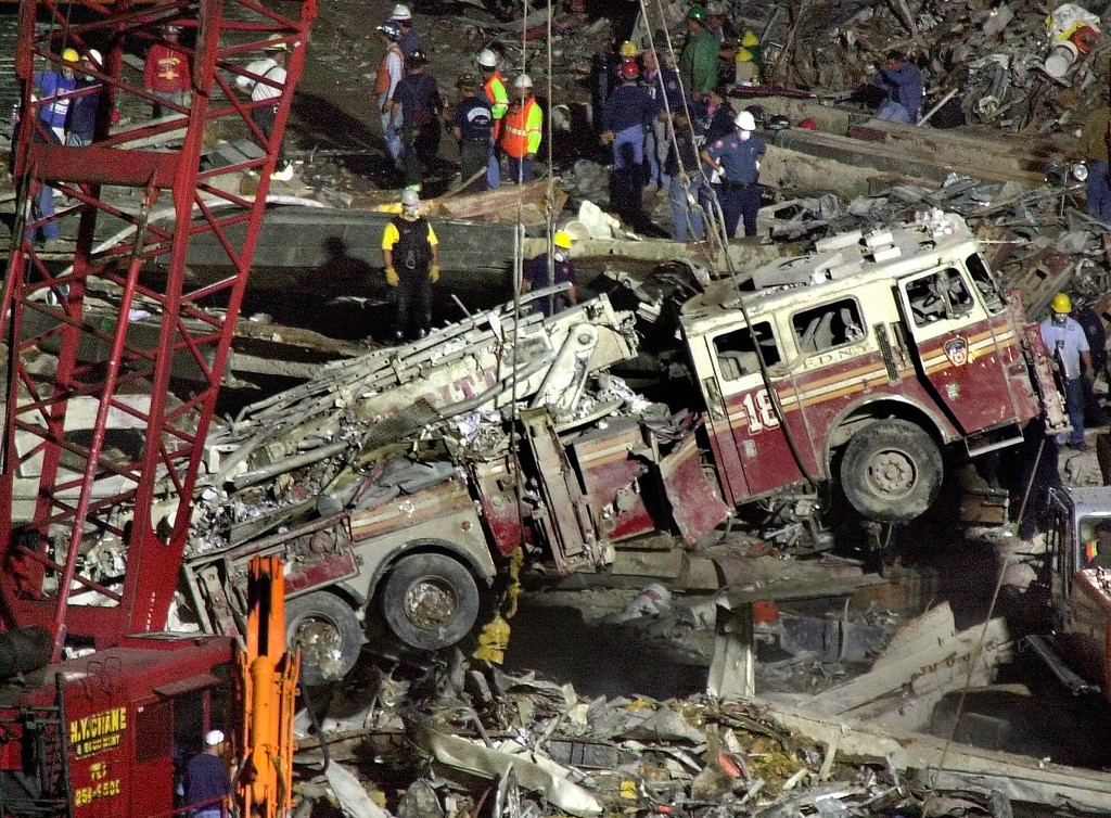 . Work crews lift a fire truck from the debris of the collapsed World Trade Center in Lower Manhattan on Saturday evening, Sept. 15, 2001.  (AP Photo/Charles Krupa)