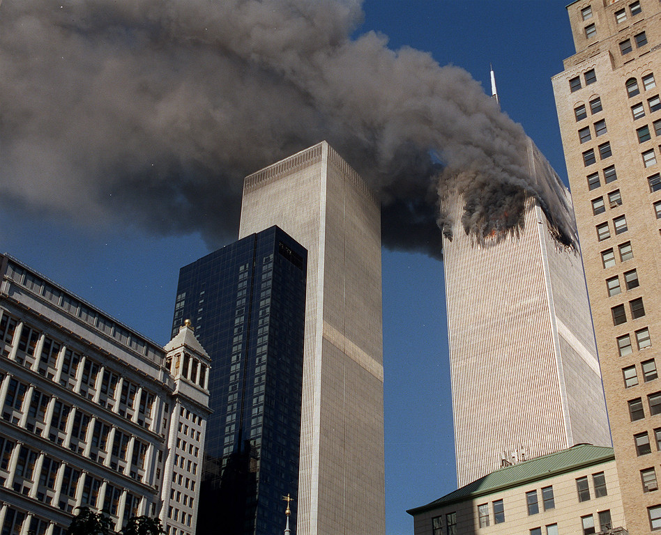 . World Trade Center Tuesday, September 11, 2001, after terrorists crashed a plane into the building.  Minutes later a second plane was crashed into the second tower. (AP Photo/Chao Soi Cheong)