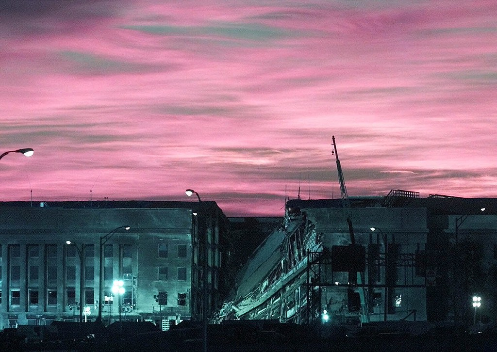 . The early morning sun lights the sky behind the damaged section of the Pentagon Thursday, Sept. 13, 2001, as rescue work continues at the Pentagon after terrorist crashed a hijacked airliner into the Pentagon Tuesday.   (AP Photo/Ron Edmonds)