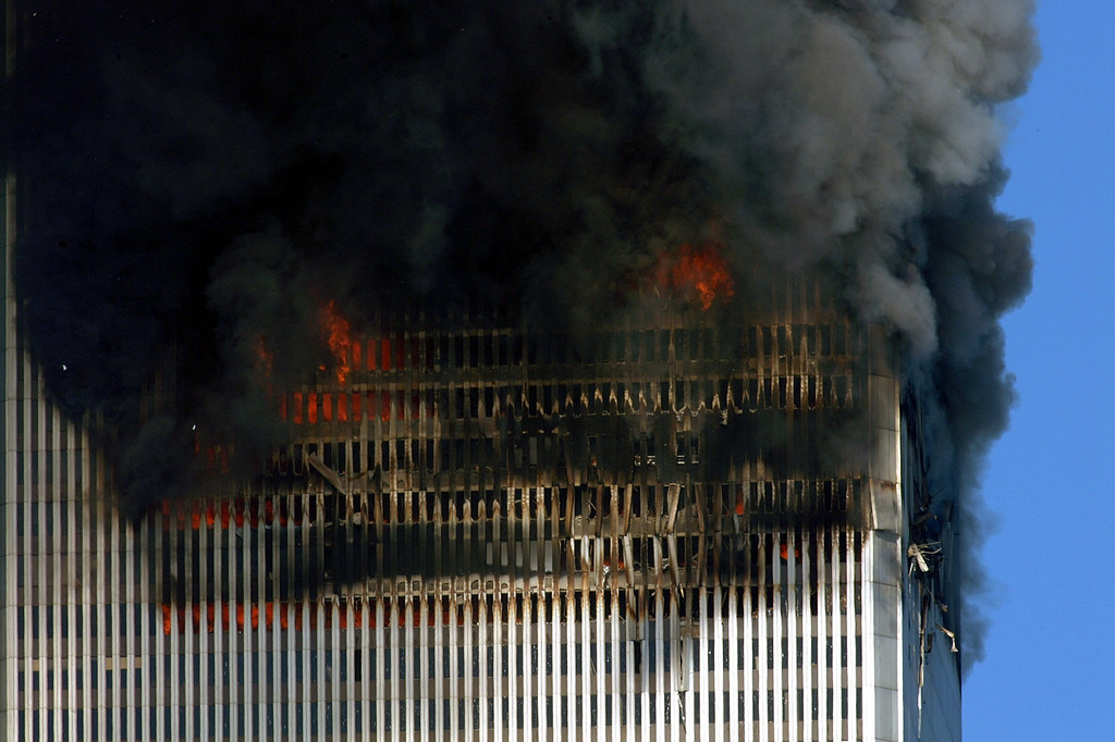 . Smoke and flames billow out of the World Trade towers before its collapse 11 September, 2001 in New York.    (HENNY RAY ABRAMS/AFP/Getty Images)