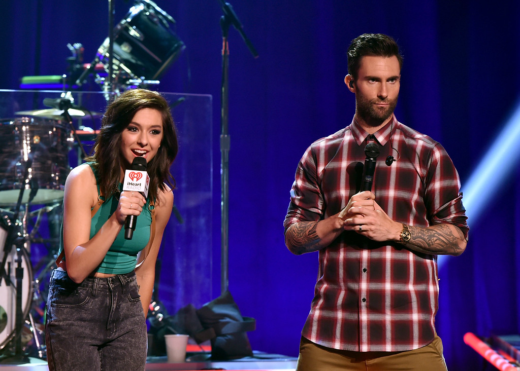. BURBANK, CA - AUGUST 26:  Singers Christina Grimmie (L) and Adam Levine speak onstage druing the iHeartRadio Album Release Party with Maroon 5 LIVE on the CW at iHeartRadio Theater on August 26, 2014 in Burbank, California.  (Photo by Kevin Winter/Getty Images for Clear Channel)