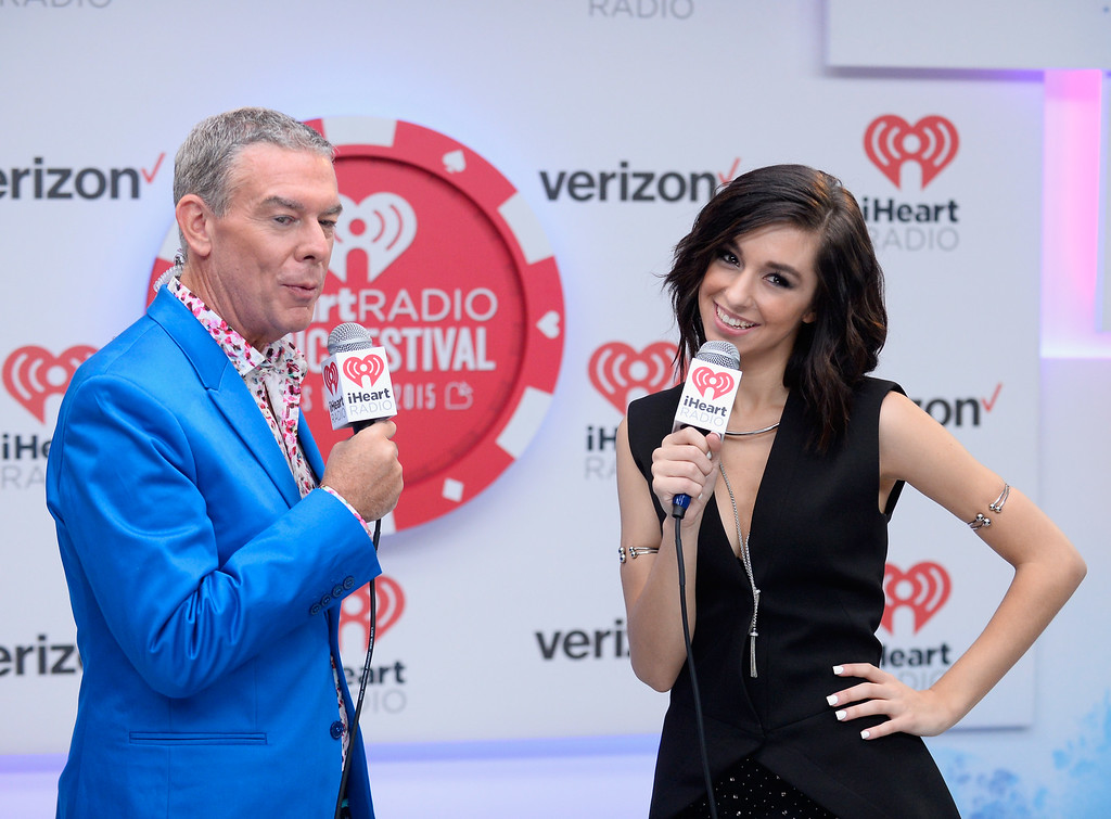 . LAS VEGAS, NV - SEPTEMBER 18:  Presenter Elvis Duran (L) and singer Christina Grimmie speak during the 2015 iHeartRadio Music Festival at MGM Grand Garden Arena on September 18, 2015 in Las Vegas, Nevada.  (Photo by Bryan Steffy/Getty Images for iHeartMedia)