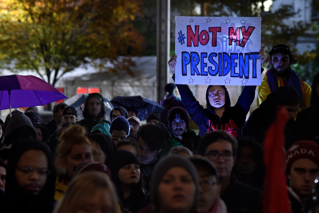 . Maddy Ballard, of Philadelphia, participates in a protest at City Hall\'s Thomas Paine Plaza, Wednesday, Nov. 9, 2016,  in opposition of Donald Trump\'s presidential election victory. (Tom Gralish/The Philadelphia Inquirer via AP)