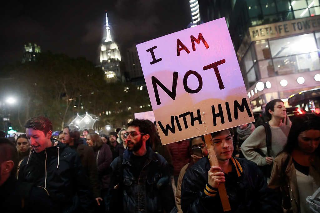 . NEW YORK, NY - NOVEMBER 9: Hundreds of anti-Donald Trump protestors march through the street on 6th Avenue on their way to Trump Tower, November 9, 2016 in New York City. Republican candidate Donald Trump won the 2016 presidential election in the early hours of the morning in a widely unforeseen upset. (Photo by Drew Angerer/Getty Images)