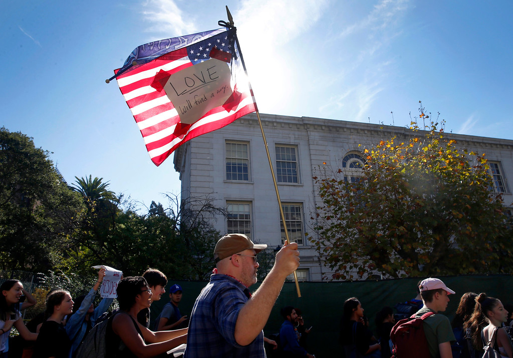 . Berkeley High School teacher Chris Gilmartin marches with thousands of high school students to Sproul Plaza on the University of California, Berkeley campus to protest the presidential election of Donald Trump, Wednesday, Nov. 9, 2016, in Berkeley, Calif. (Paul Chinn/San Francisco Chronicle via AP)