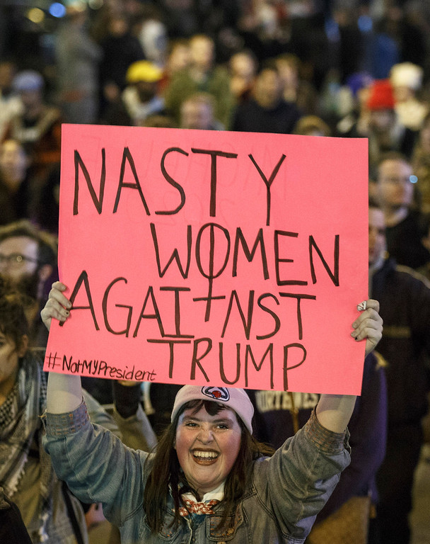 . CHICAGO, IL - NOVEMBER 09: Demonstrators protest on Michigan Avenue November 9, 2016 in Chicago, Illinois. Thousands of people across the United States took to the streets in protest a day after Republican Donald Trump was elected president, defeating Democrat Hillary Clinton. (Photo by John Gress/Getty Images)