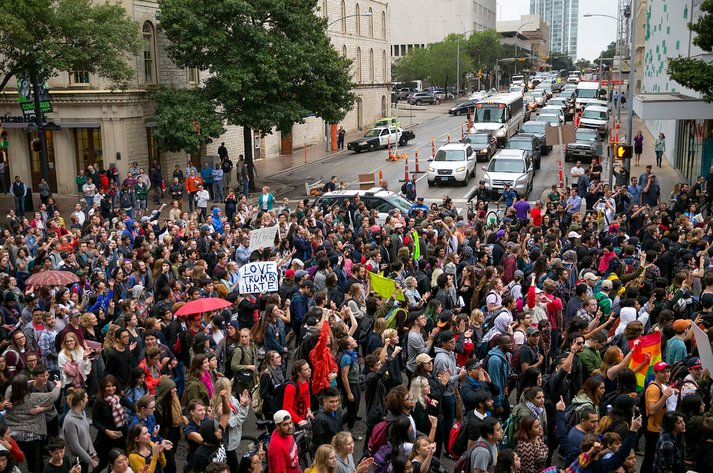 . Anti-Trump protesters march along Congress Avenue in Austin, Texas, on Wednesday November 9, 2016. Hundreds of University of Texas students march through downtown Austin in protest of Donald Trump\'s presidential victory. (Jay Janner/Austin American-Statesman via AP)