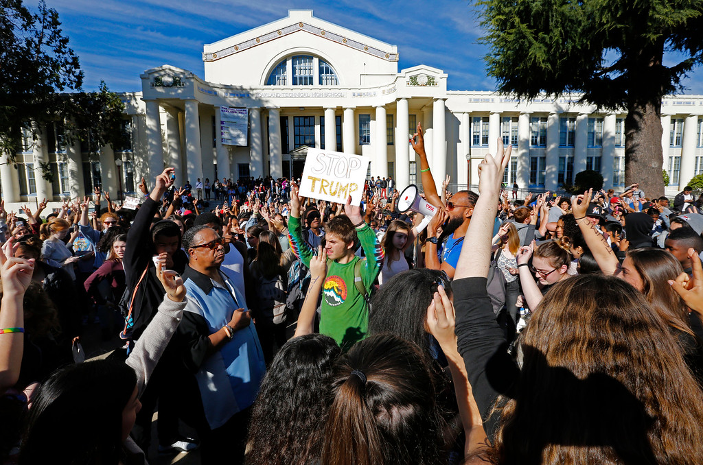 . Students and faculty participate in a late morning rally outside their school at Oakland Technical High School in Oakland, Calif., on Wednesday, Nov. 9, 2016, in opposition of Donald Trump\'s presidential election victory. The rally was student led and organized through social media.  (Laura A. Oda/San Jose Mercury News via AP)