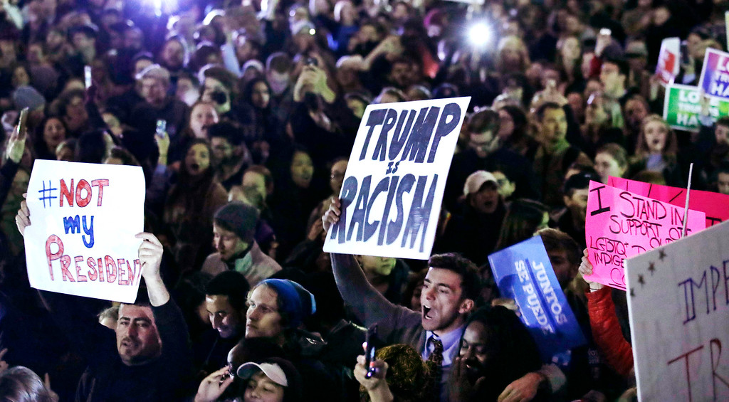 . Hundreds protest in opposition of Donald Trump\'s presidential election victory on Boston Common in Boston, Wednesday evening, Nov. 9, 2016. (AP Photo/Charles Krupa)