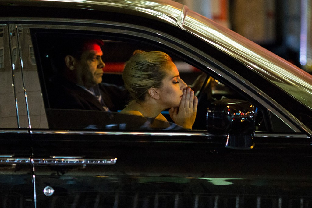 . Musician Lady Gaga sits in her car after staging a protest against Republican presidential nominee Donald Trump outside Trump Tower in New York City after midnight on election day November 9, 2016. Donald Trump stunned America and the world, riding a wave of populist resentment to defeat Hillary Clinton in the race to become the 45th president of the United States. The Republican mogul defeated his Democratic rival, plunging global markets into turmoil and casting the long-standing global political order, which hinges on Washington\'s leadership, into doubt. (DOMINICK REUTER/AFP/Getty Images)