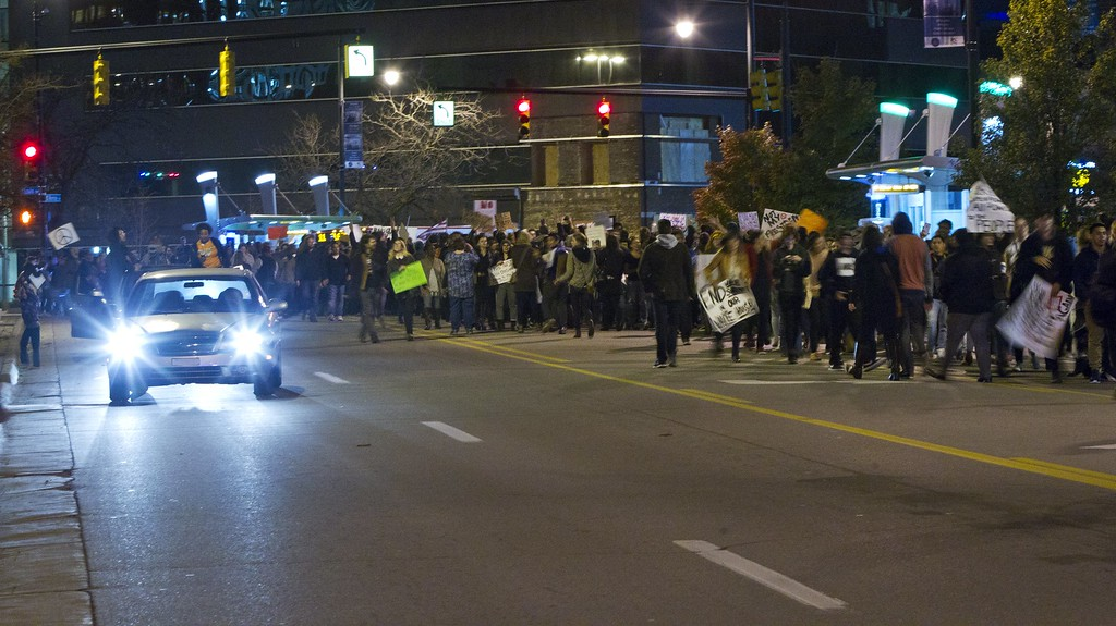 . Protesters march down Monroe Ave. NW in Grand Rapids, Mich.,  Thursday, Nov. 10, 2016, in opposition of Donald Trump\'s presidential election victory. (Cory Morse/The Grand Rapids Press via AP)