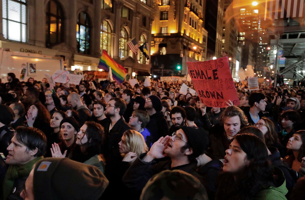 . Protesters chant slogans on Fifth Avenue outside Trump Tower, Wednesday, Nov. 9, 2016, in New York, in opposition of Donald Trump\'s presidential election victory. (AP Photo/Julie Jacobson)