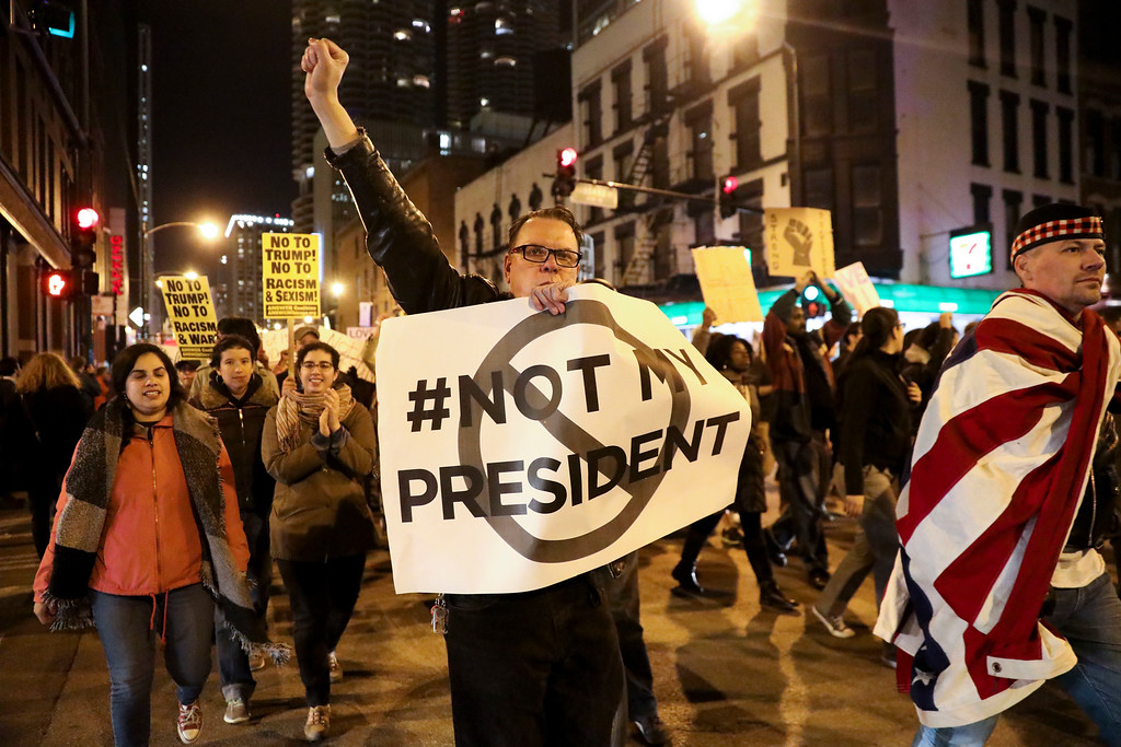 . Protesters march North on State Street to express their disapproval of the election of Donald Trump as the 45th president of the United States, Wednesday, Nov. 9, 2016 in Chicago. (Armando L. Sanchez/Chicago Tribune via AP)