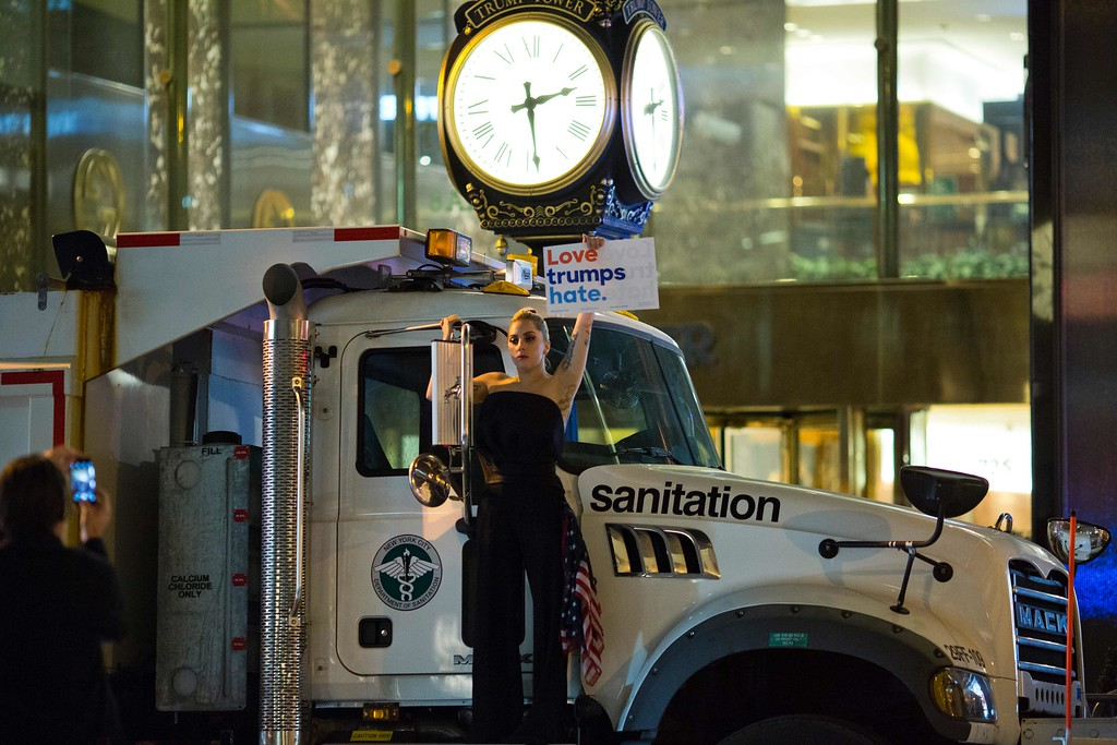 . Musician Lady Gaga stages a protest against Republican presidential nominee Donald Trump on a sanitation truck outside Trump Tower in New York City after midnight on election day November 9, 2016. Donald Trump stunned America and the world, riding a wave of populist resentment to defeat Hillary Clinton in the race to become the 45th president of the United States. The Republican mogul defeated his Democratic rival, plunging global markets into turmoil and casting the long-standing global political order, which hinges on Washington\'s leadership, into doubt. (DOMINICK REUTER/AFP/Getty Images)