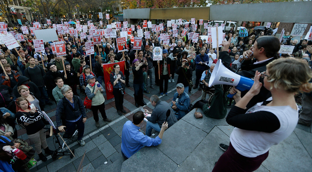 . Hundreds of protesters take part in a protest against the election of President-elect Donald Trump, Wednesday, Nov. 9, 2016, in downtown Seattle. (AP Photo/Ted S. Warren)