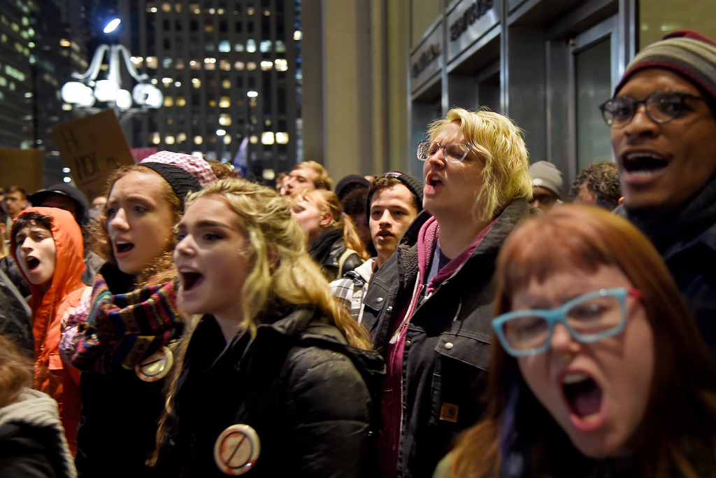 . Demonstrators shout during a protest in City Hall\'s Thomas Paine Plaza, Wednesday, Nov. 9, 2016,  in opposition of Donald Trump\'s presidential election victory. (Tom Gralish/The Philadelphia Inquirer via AP)