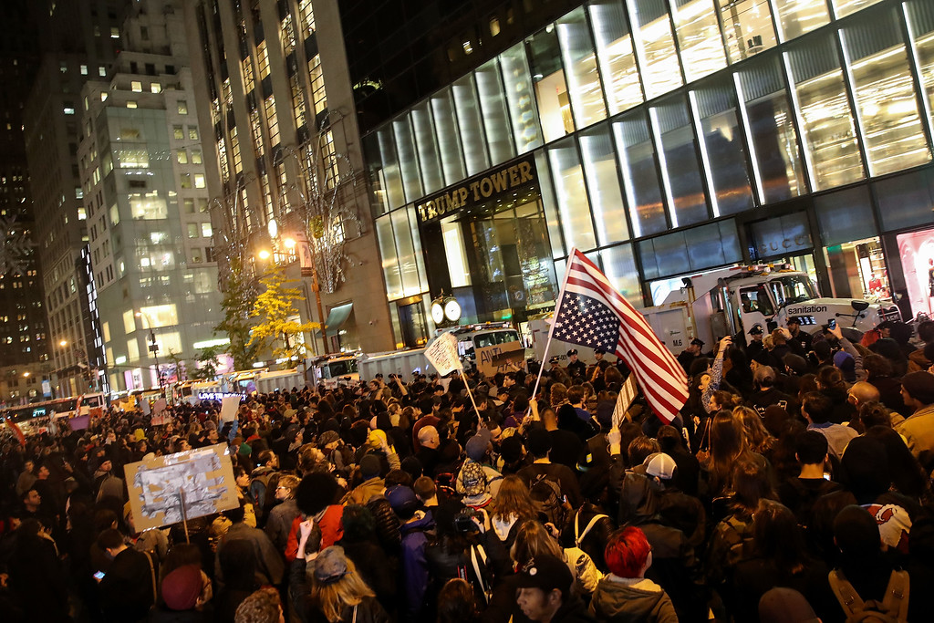 . NEW YORK, NY - NOVEMBER 9: Hundreds of protestors rallying against Donald Trump gather outside of Trump Tower, November 9, 2016 in New York City. Republican candidate Donald Trump won the 2016 presidential election in the early hours of the morning in a widely unforeseen upset. (Photo by Drew Angerer/Getty Images)