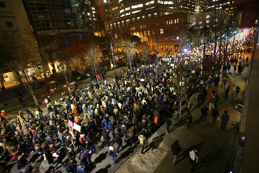 . SEATTLE, WA - NOVEMBER 09: Thousands of protesters march down 2nd Avenue on November 9, 2016 in Seattle, Washington. Demostrations in multiple cities around the country were held the day following Donald Trump\'s upset win in last night\'s U.S. presidential election.  (Photo by Karen Ducey/Getty Images)