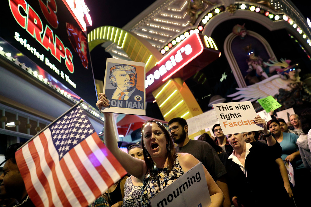 . Protesters demonstrate in opposition to the election of President-elect, Donald Trump, march along the Las Vegas Strip, Saturday, Nov. 12, 2016, in Las Vegas. Tens of thousands of people marched in streets across the United States on Saturday, staging the fourth day of protests of Trump\'s surprise victory as president. (AP Photo/John Locher)
